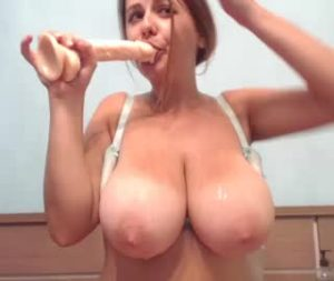 Busty British Girl Julie Sucks Her Dildo On Cam