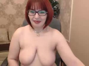 Mature Redhead Woman Aurora Gets Topless