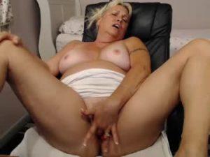 Big Breasted Blonde Milf Janie Fingers Herself Hard