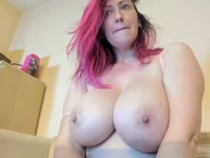 Pink Haired Milf Celinne With Huge Boobs