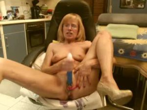 Blonde Granny Silvie Pokes Her Pussy With A Vibrator