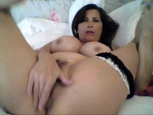 Mature Woman Flashes Her Big Tits And Masturbates Her Hairy Cunt